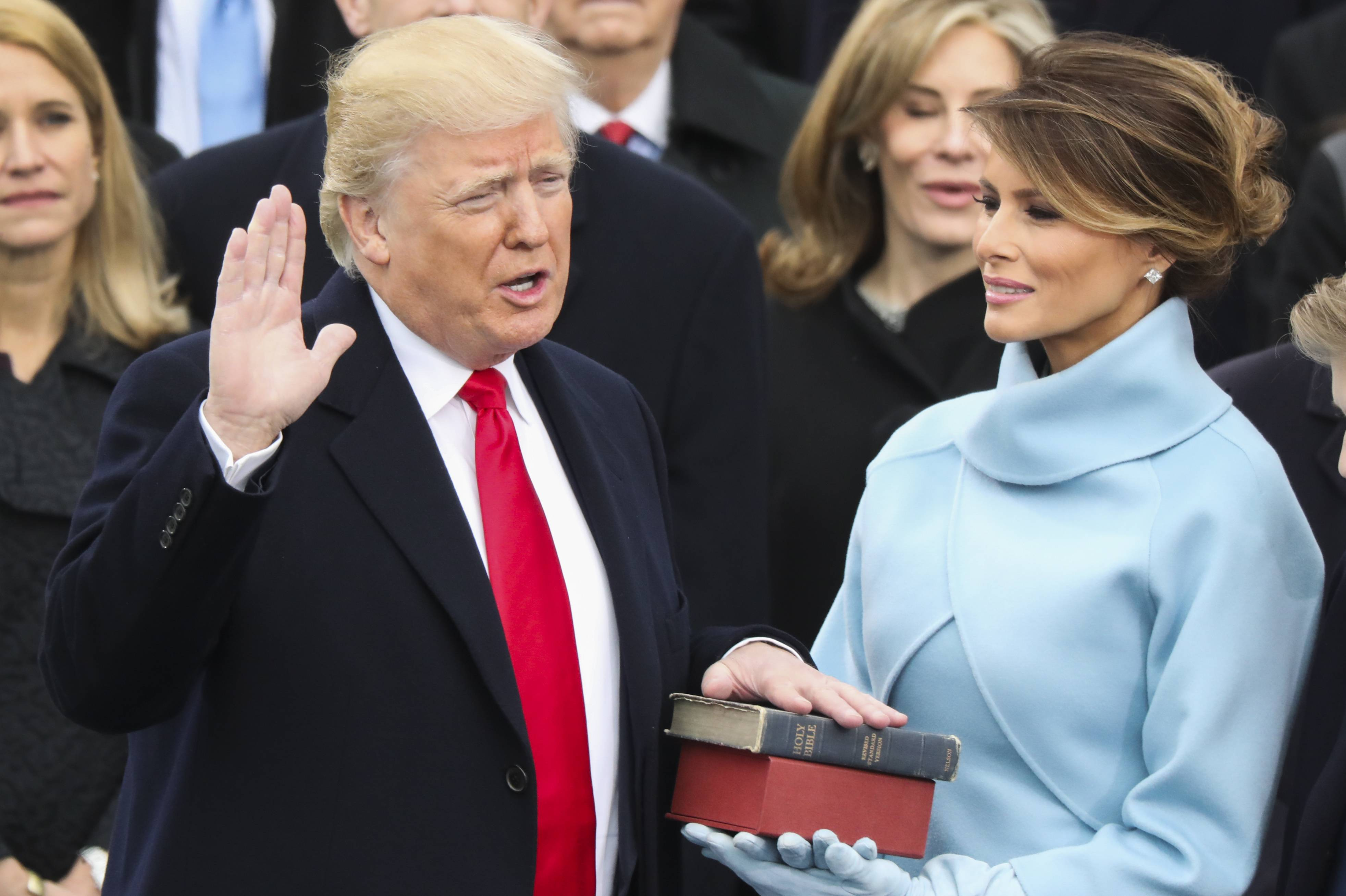 Donald Trump is sworn in as the 45th president of the United States as Melania Trump looks on during the 58th Presidential Inauguration at the U.S. Capitol in Washington, Friday, Jan. 20, 2017.