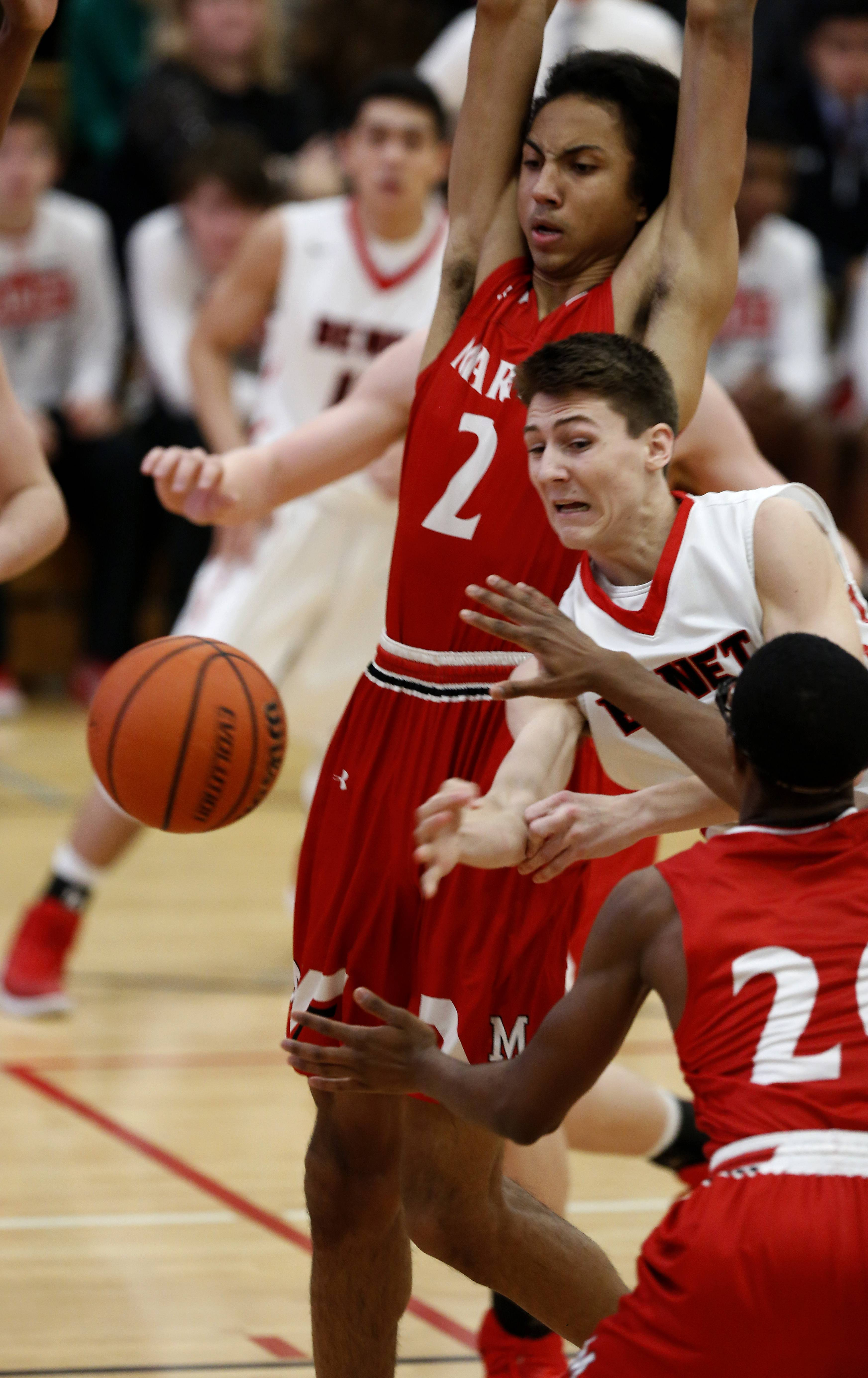 Benet Academy's Jack Nolan drives in the lane against Marist's Justin Brown during boys basketball action in Lisle.