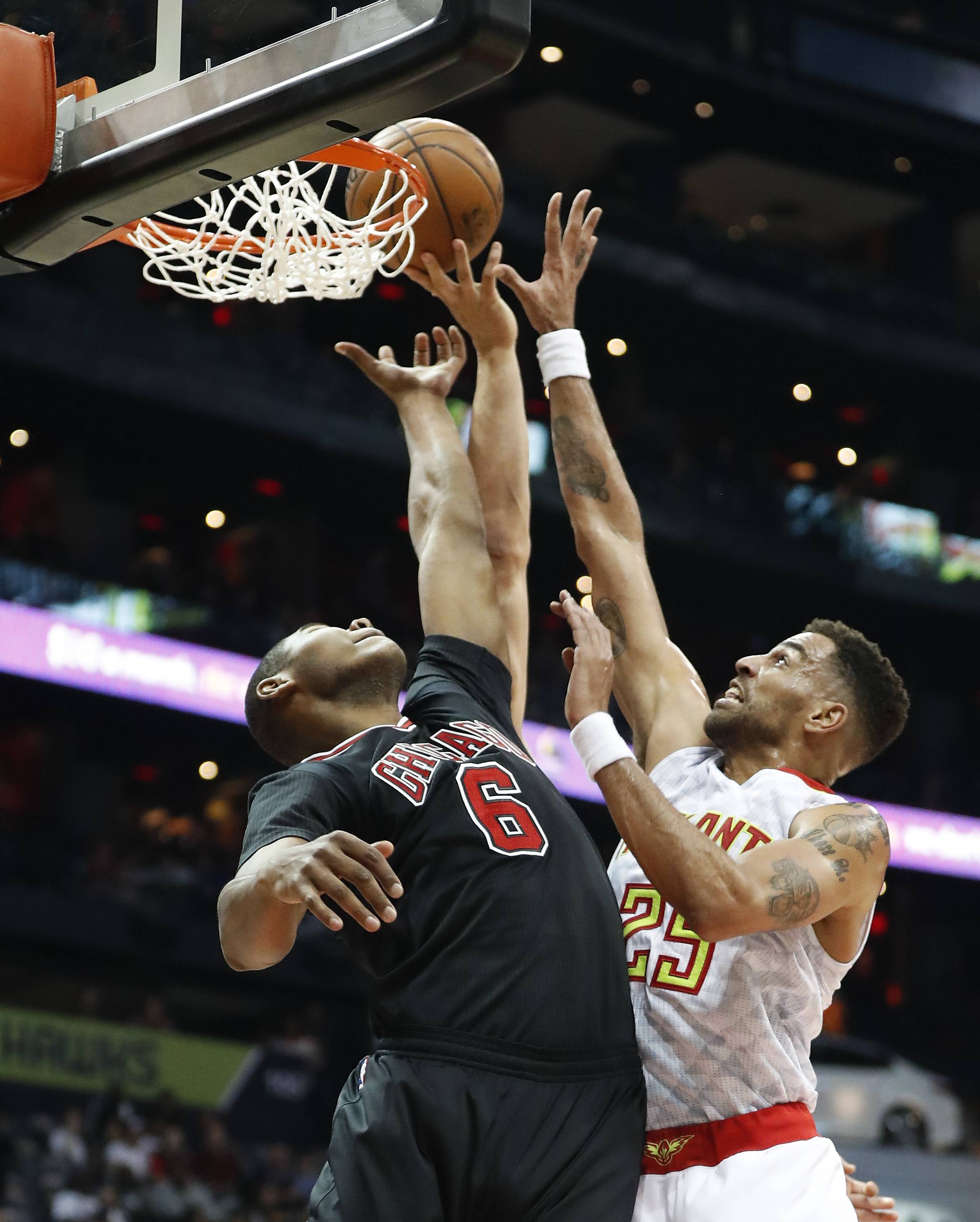 Chicago Bulls forward Cristiano Felicio (6) is defended by Atlanta Hawks forward Thabo Sefolosha (25) as he goes up for a basket in the first half of an NBA basketball game Friday, Jan. 20, 2017, in Atlanta.