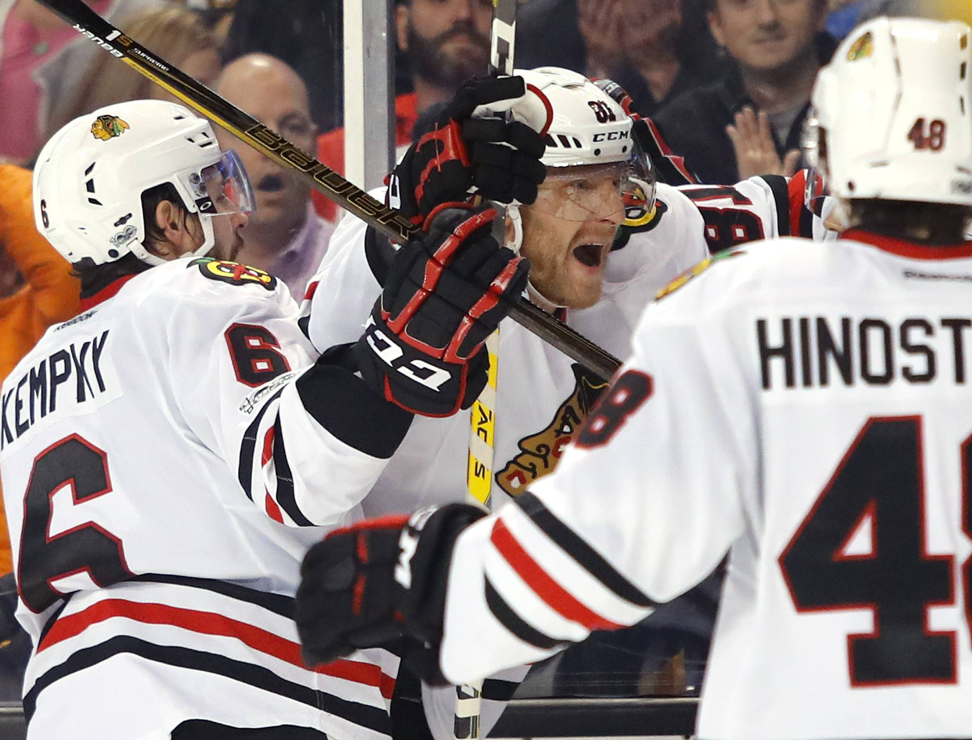Chicago Blackhawks' Marian Hossa, center, celebrates his goal with Vinnie Hinostroza and Michal Kempny (6) during the third period of the Chicago Blackhawks 1-0 win over the Boston Bruins in an NHL hockey game in Boston Friday, Jan. 20, 2017.