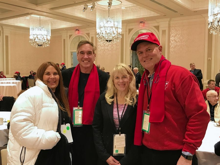 """Up before dawn, through security and in holding area before heading out to the west lawn for the inaugural,"" was how Republican National Committeeman Richard Porter described his morning Friday. Porter, left, is joined by wife Lydia Marti, second from right, and Illinois GOP Chairman Tim Schneider, second from left, in this photo."
