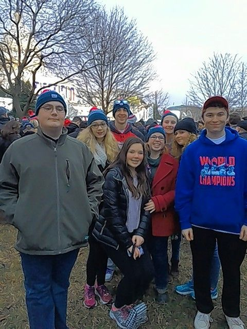 Eight students from Naperville Central High School gather on the Capitol Lawn early Friday to wait for the inauguration ceremony to begin.