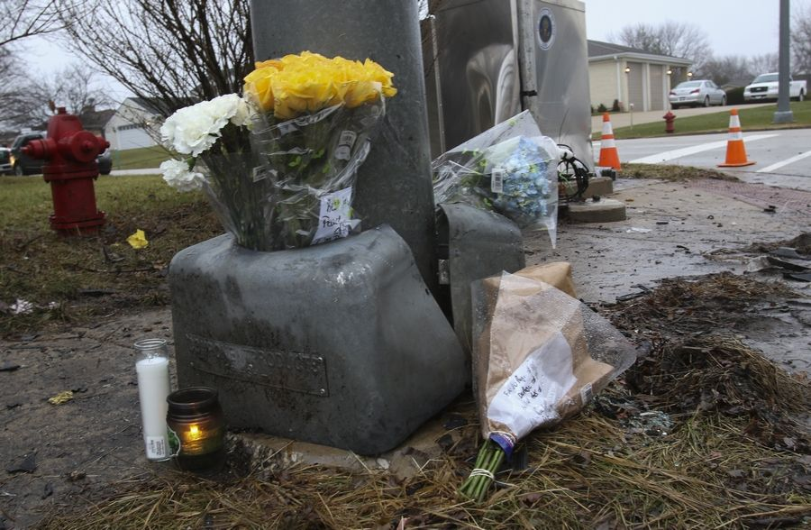 A makeshift memorial has been created at Army Trail Road and Cardinal Avenue where a Bloomingdale police officer was killed Thursday night in a one-car crash.