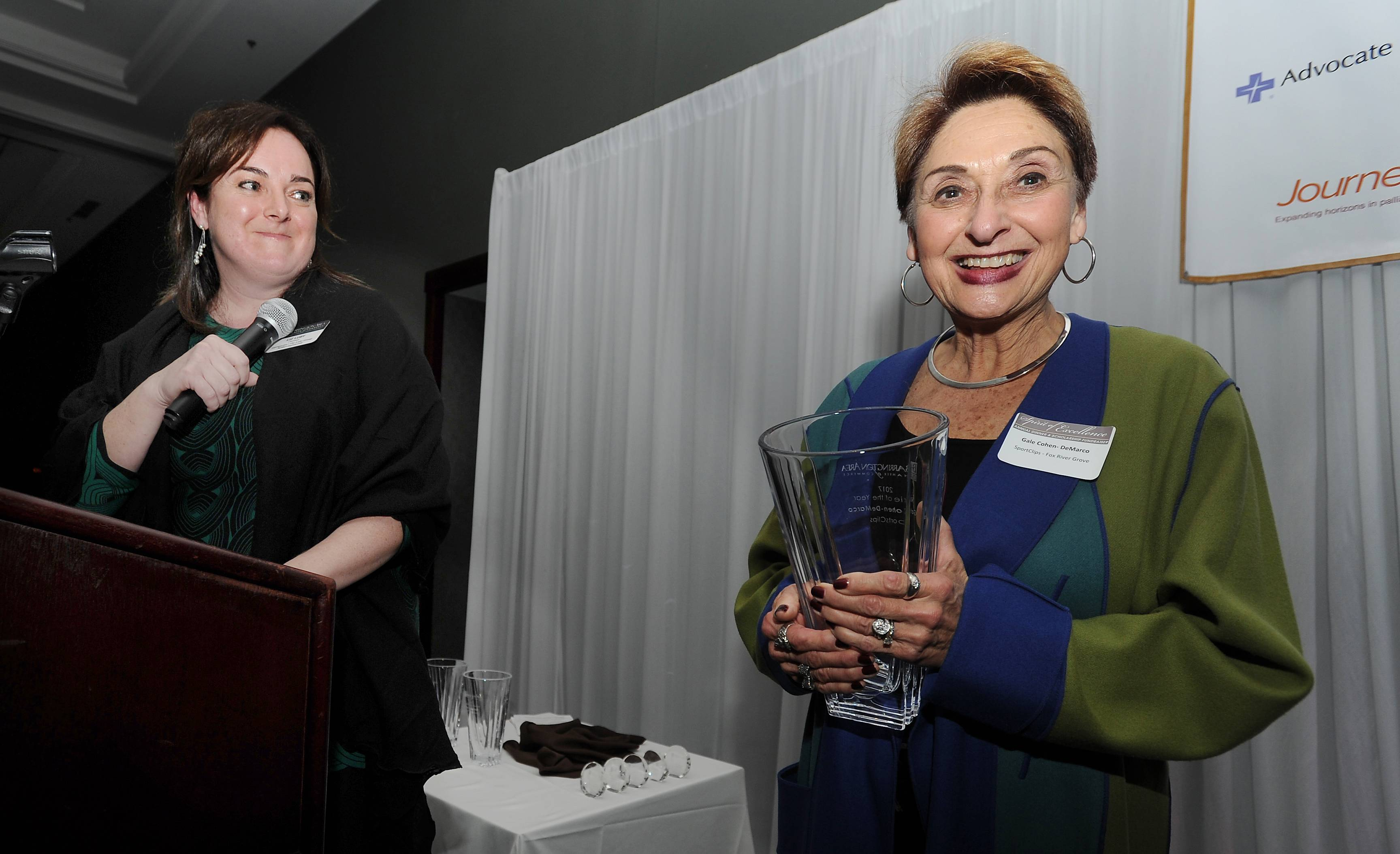 Mark Welsh/mwelsh@dailyherald.comGale Demarco-Cohen of SportsClips-Fox River Grove won the BACC Rookie of the Year Award Thursday night. Barrington Area Chamber Chairman Liz Luby (left) announced the winners.