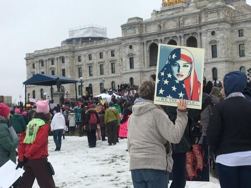 A protester holds sign at Minnesota Women's March in front of state Capitol in St. Paul, Minn., on Saturday, Jan. 21, 2017.  The march was held in in conjunction with with similar events taking place around the nation following the inauguration of President Donald Trump.