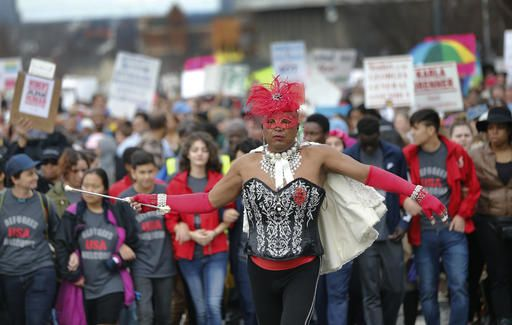 Demonstrators march a Women's March rally Saturday Jan. 21, 2017, in Atlanta. Thousands of people marched through Atlanta one day after President Donald Trump's inauguration.
