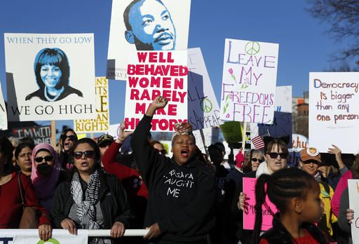 Thousands of people participate in a Women's March Saturday, Jan. 21, 2017, in St. Louis. The march was held in in conjunction with with similar events taking place in Washington and around the nation following the inauguration of President Donald Trump.