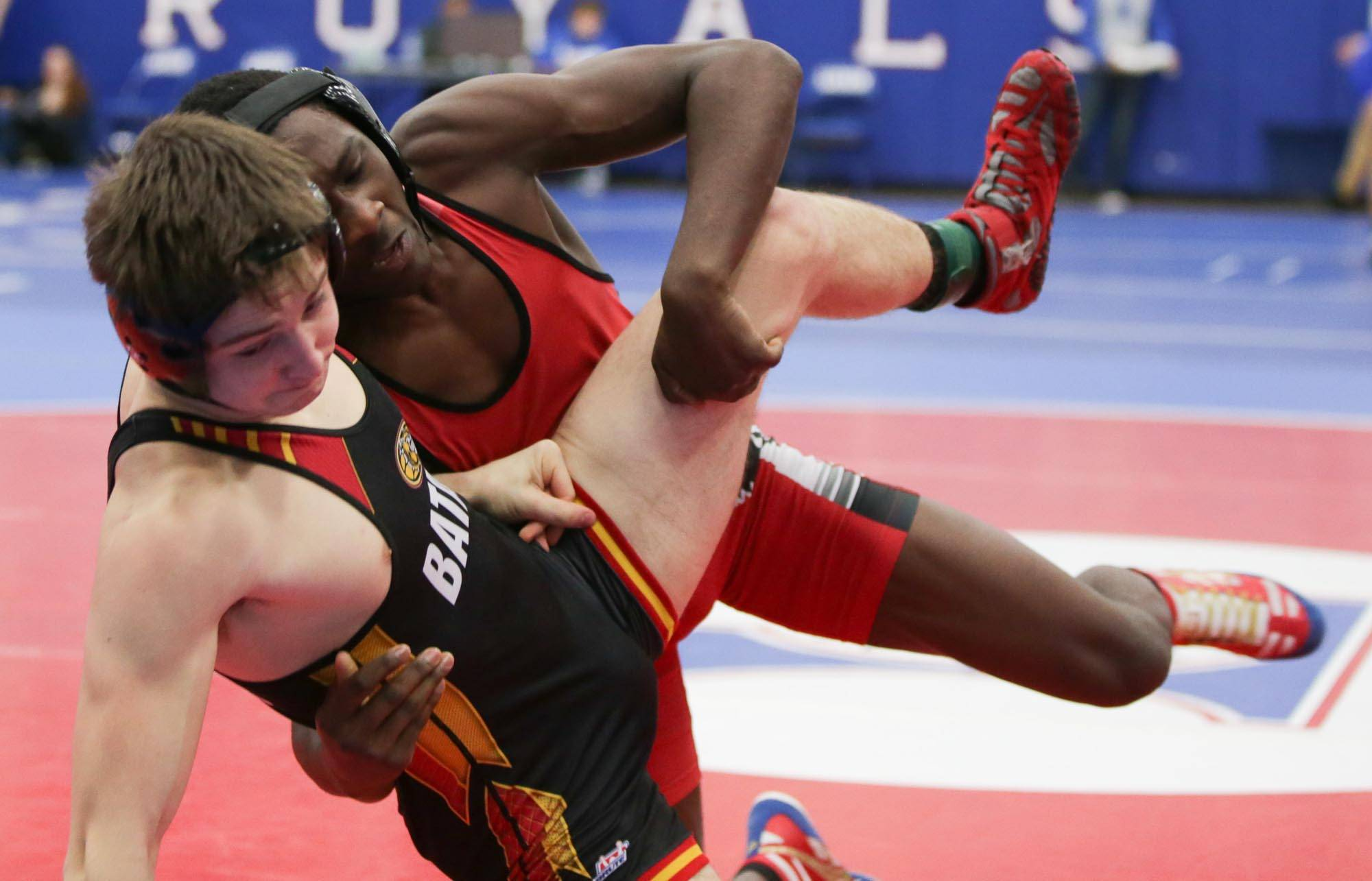 East Aurora's Matt Young shoots the legs of Batavia's Joe Posledni during their 160-pound final match at Larkin Saturday.