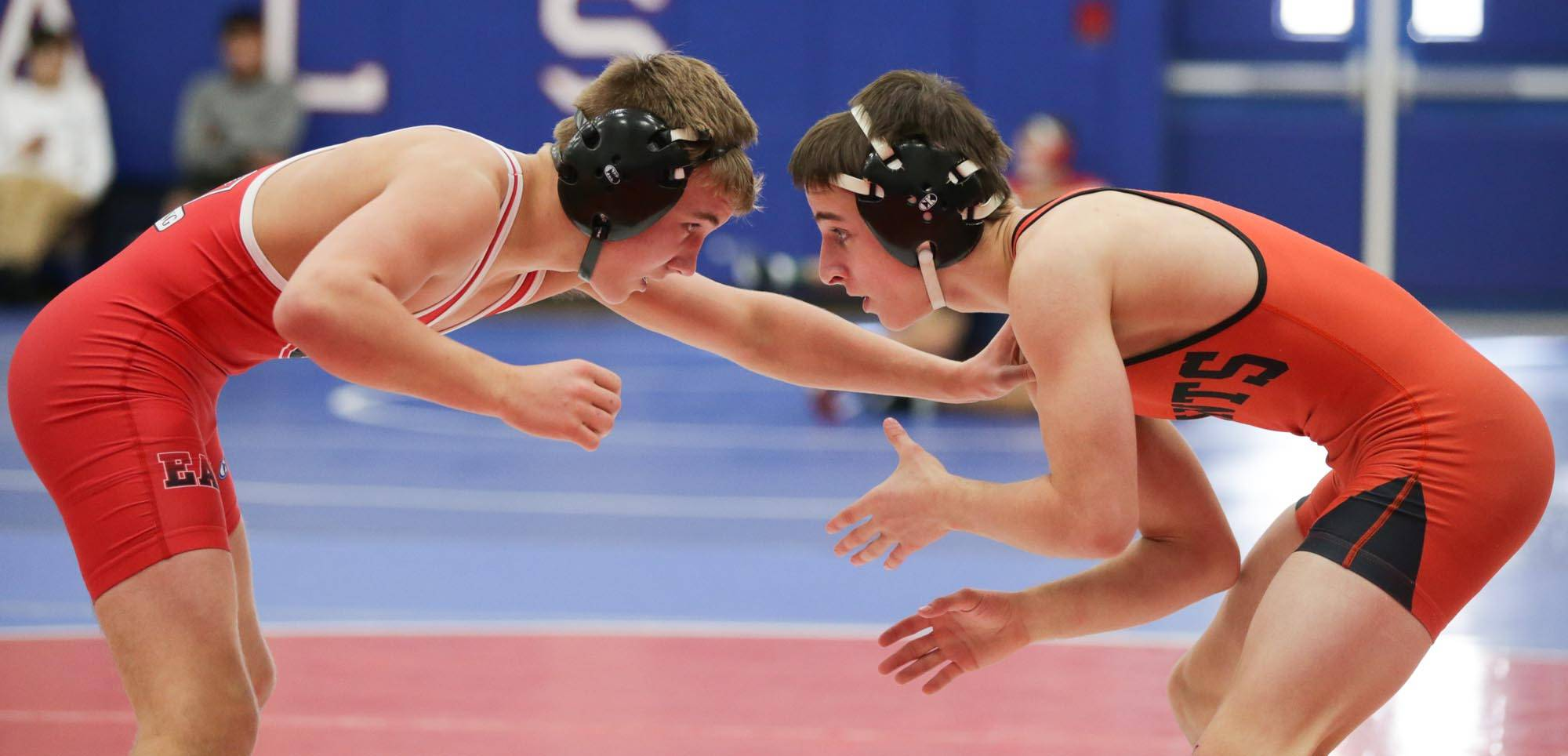 Glenbard East's Reece Martin and St. Charles East's Ben Anderson compete in the 113-pound wrestling final at Larkin Saturday.