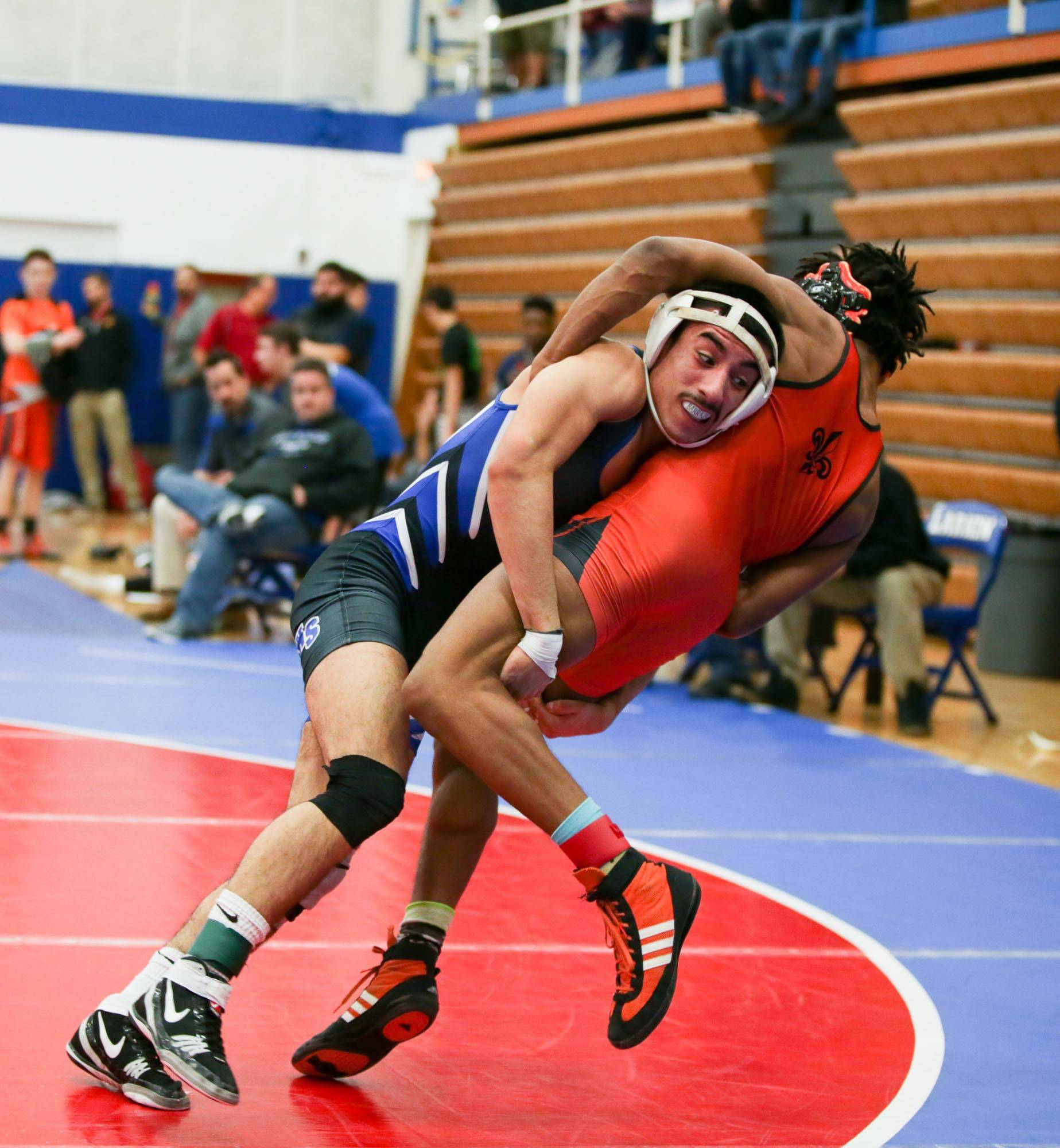 Larkin's Hugo Barraza shoots the legs of St. Charles East's Louis Gordon during their 132-pound match at Larkin Saturday.