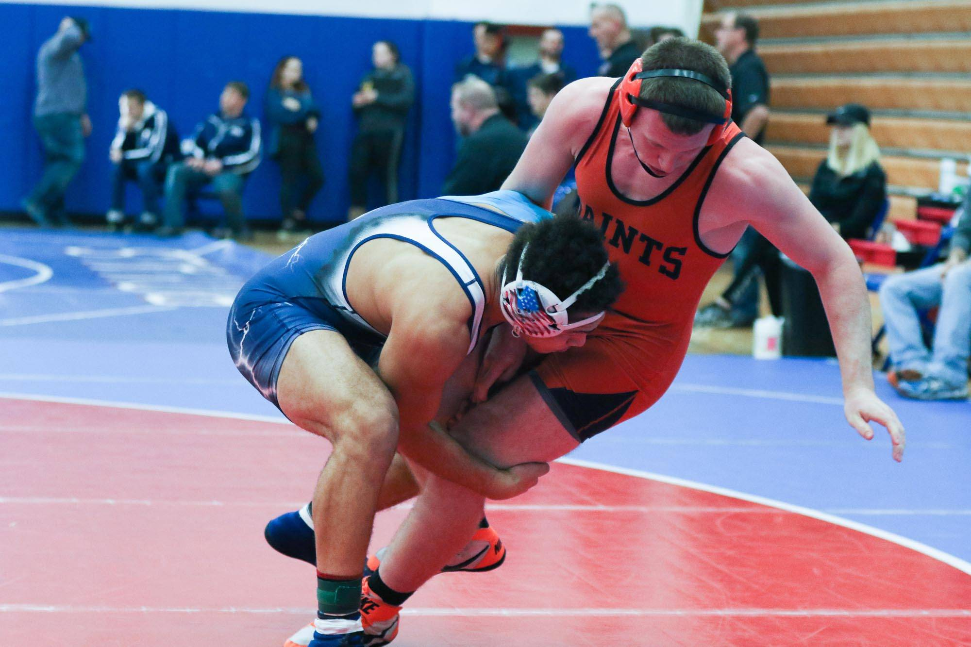 West Aurora's Steven Norman shoots the legs of St. Charles East's Cody Glidwell during their 182-pound final match at Larkin Saturday.