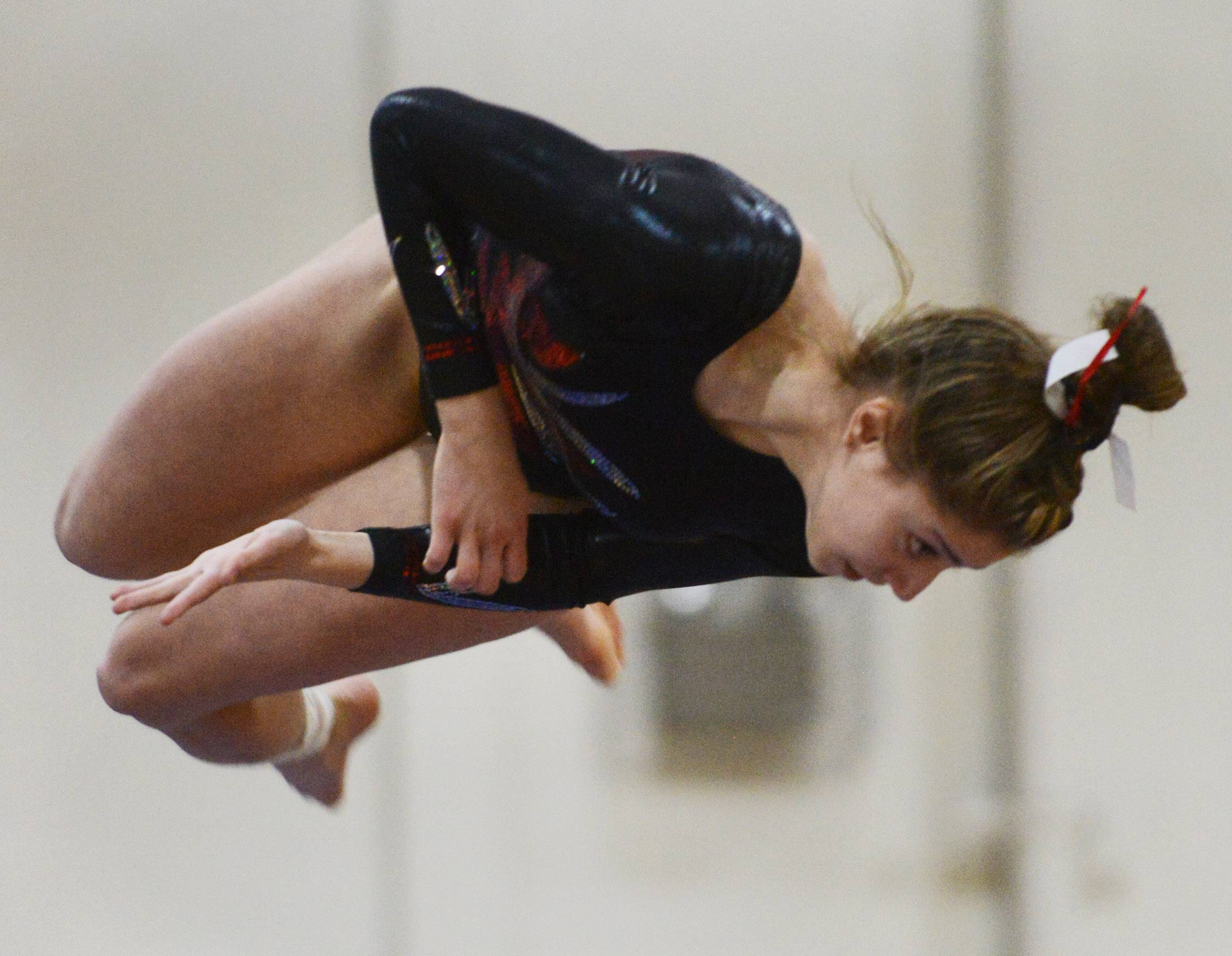 Naperville Central's Katie Petro dismounts from the balance beam during the Fremd girls gymnastics invitational in Palatine on Saturday.