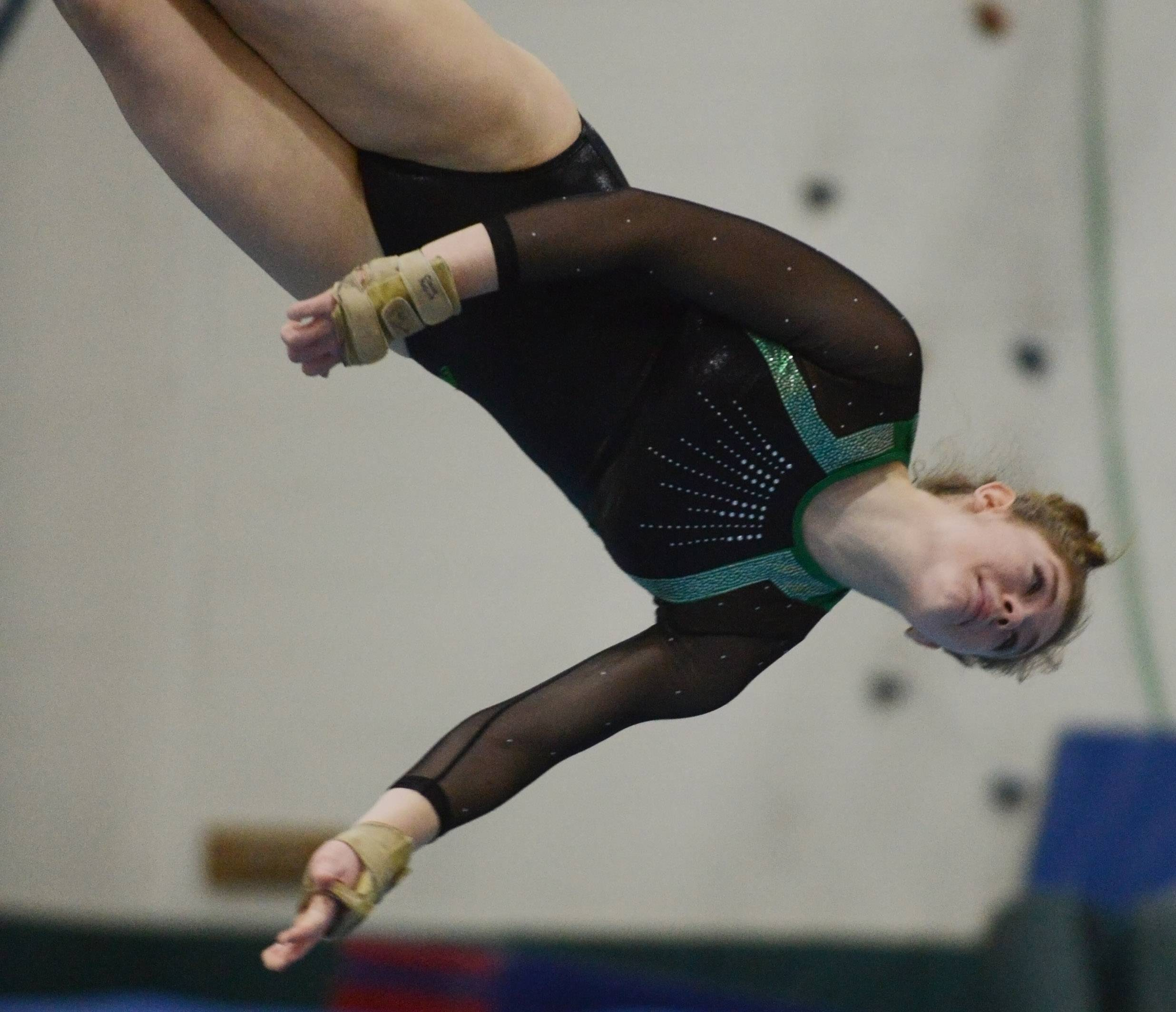 Glenbard West's Claire McGurk competes on the floor exercise during the Fremd girls gymnastics invitational in Palatine on Saturday.