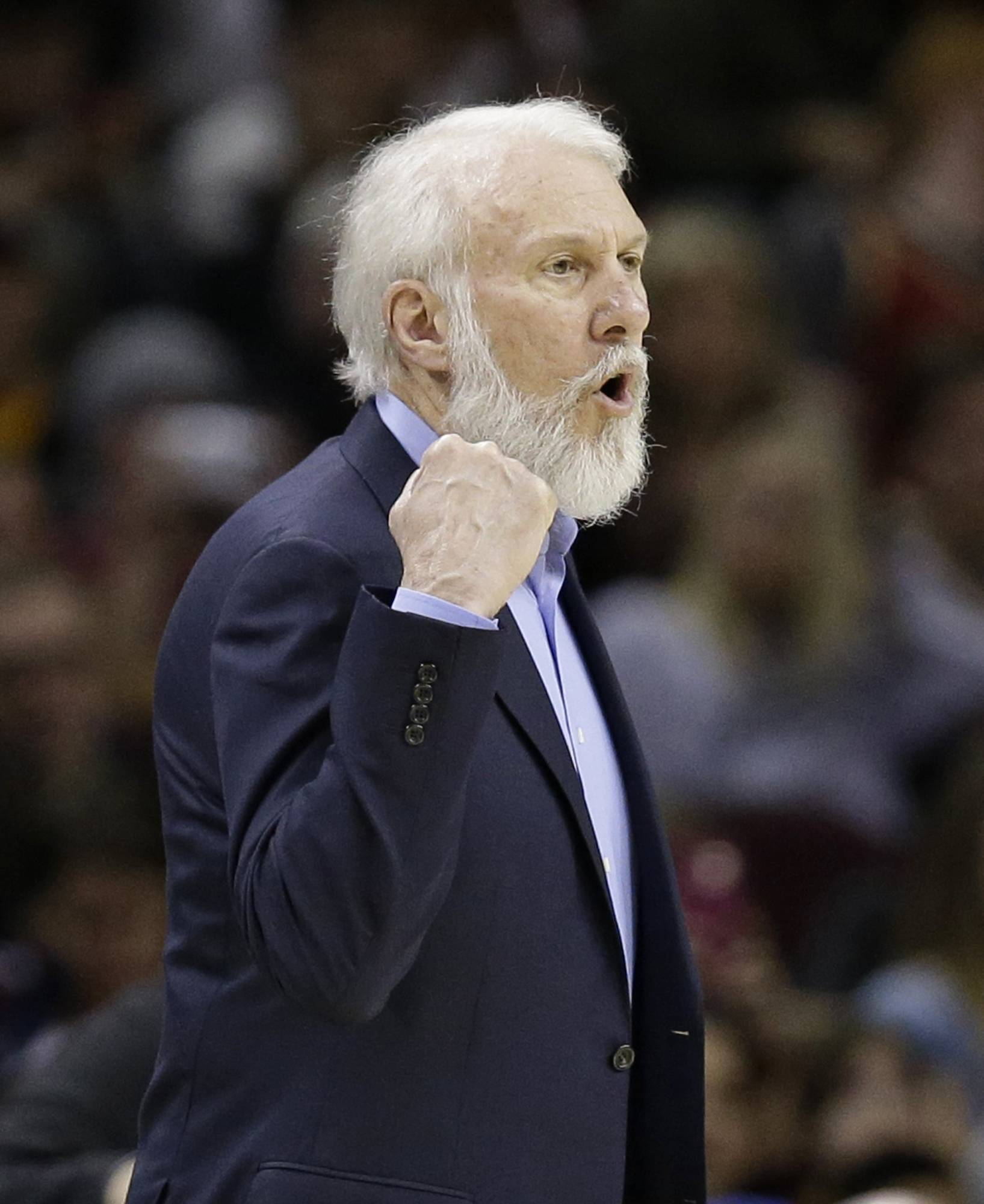 San Antonio Spurs head coach Gregg Popovich yells to players in the first half of an NBA basketball game against the Cleveland Cavaliers, Saturday, Jan. 21, 2017, in Cleveland. San Antonio's longtime coach, who has been highly critical of Donald Trump in the past, went on a lengthy rant about the newly sworn-in president on Saturday night, calling him a bully and saying he hopes he can change while in office. (AP Photo/Tony Dejak)