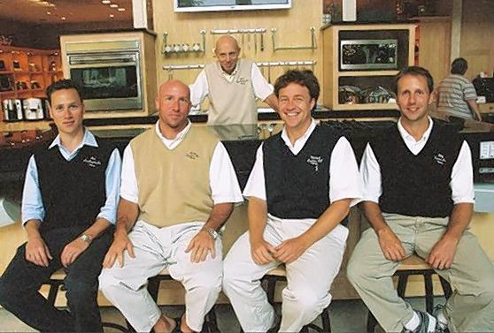 Bob Abt, in background, with his four sons Jon, from left, Ricky, Mike and Billy Abt. The brothers are now co-presidents of the company.