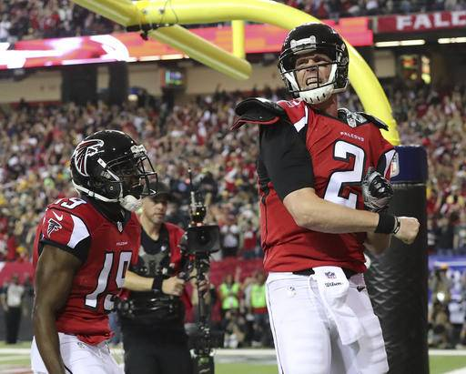 Atlanta Falcons quarterback Matt Ryan reacts to scoring a touchdown during an NFL football NFC championship game against the Green Bay Packers, Sunday, Jan. 22, 2017, in Atlanta. (Curtis Compton/Atlanta Journal-Constitution via AP)