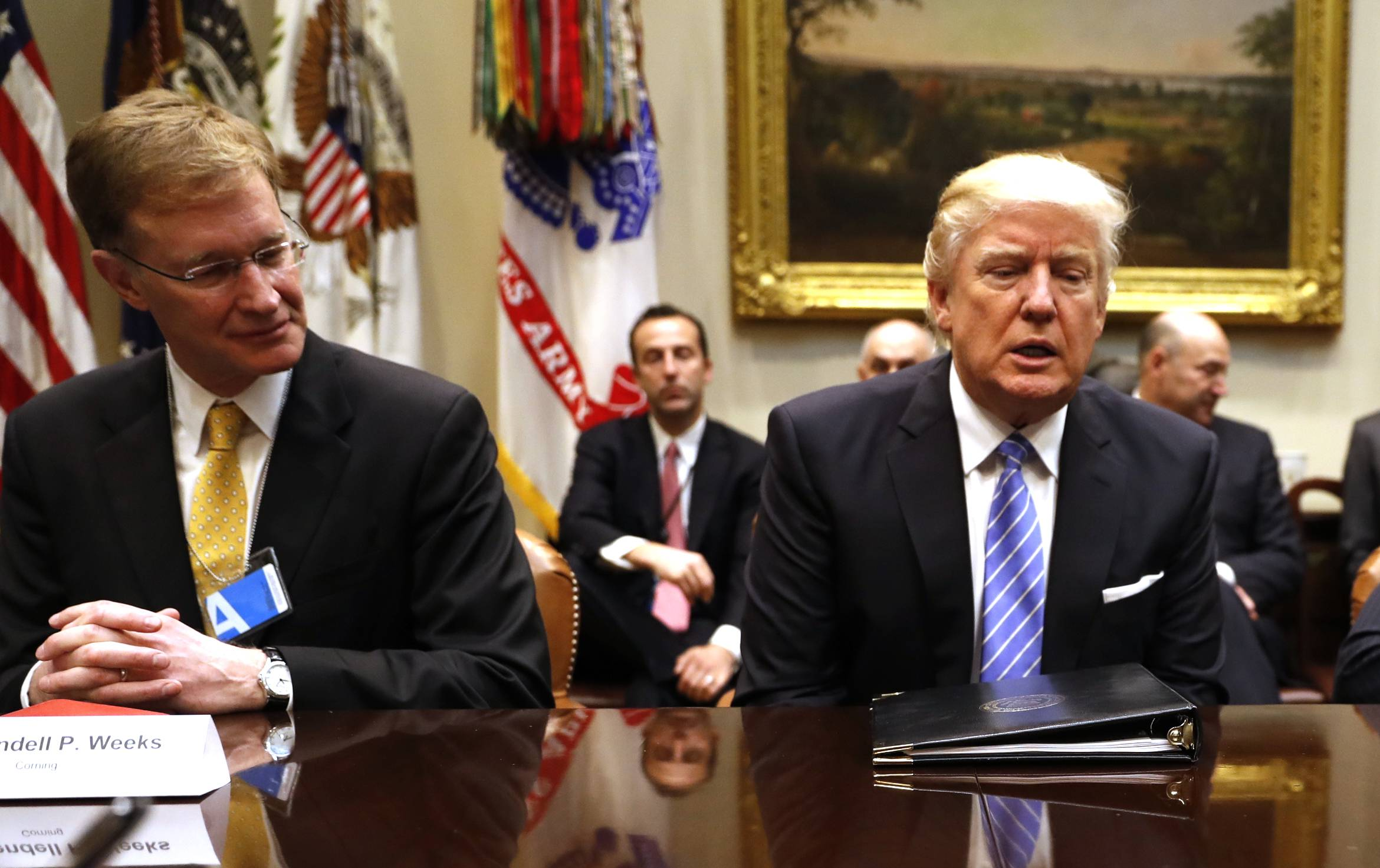 President Donald Trump meets with business leaders Monday in the Roosevelt Room of the White House.