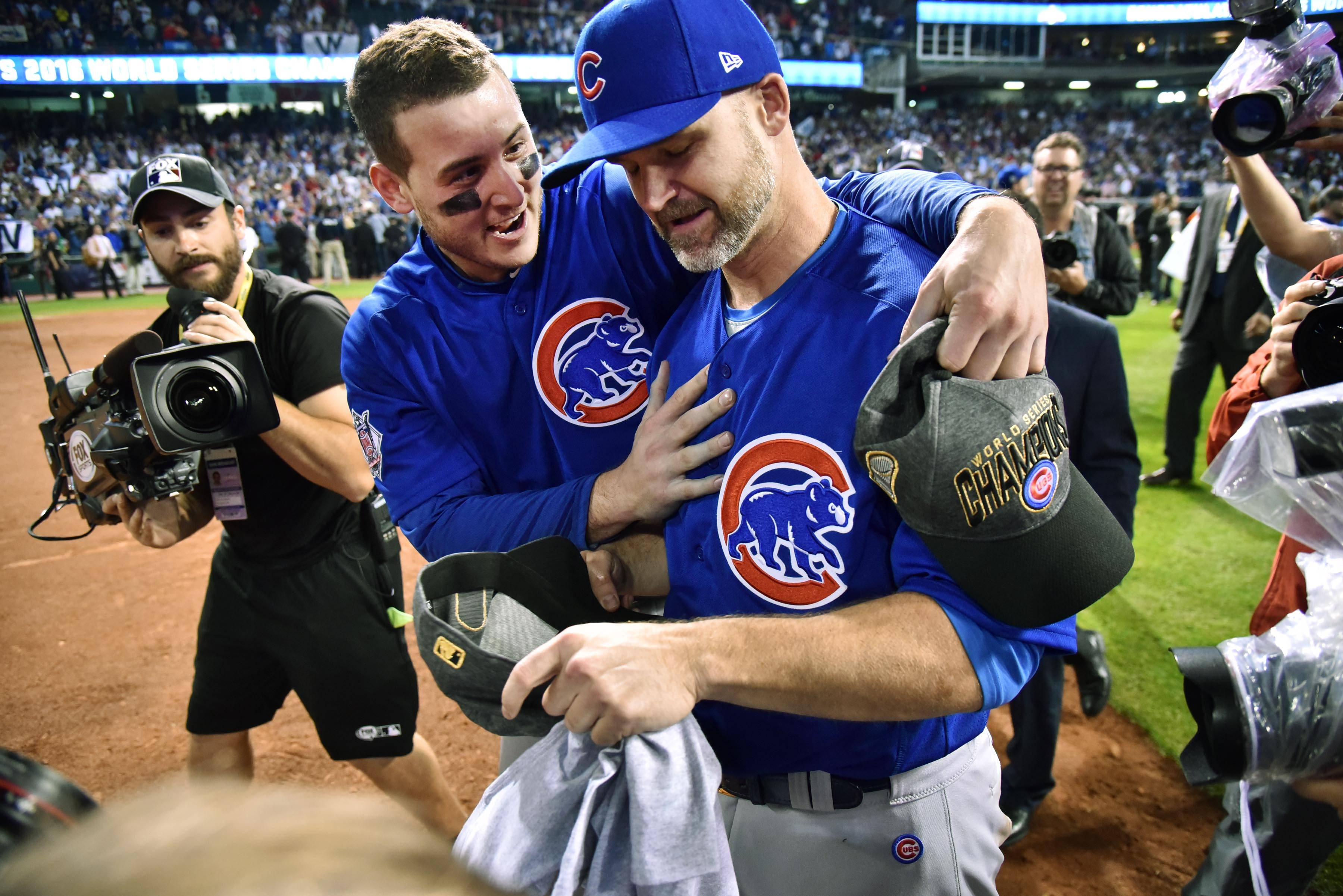 Chicago Cubs first baseman Anthony Rizzo hugs teammate David Ross Wednesday after Game 7 of the World Series at Progressive Field in Cleveland.