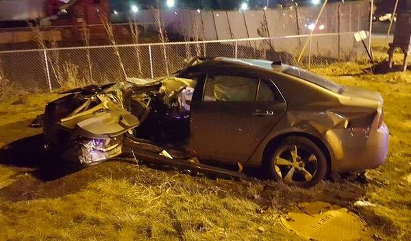 The Driver Of This Chevy Malibu Surprisingly Was Able To Walk A Waiting Stretcher After