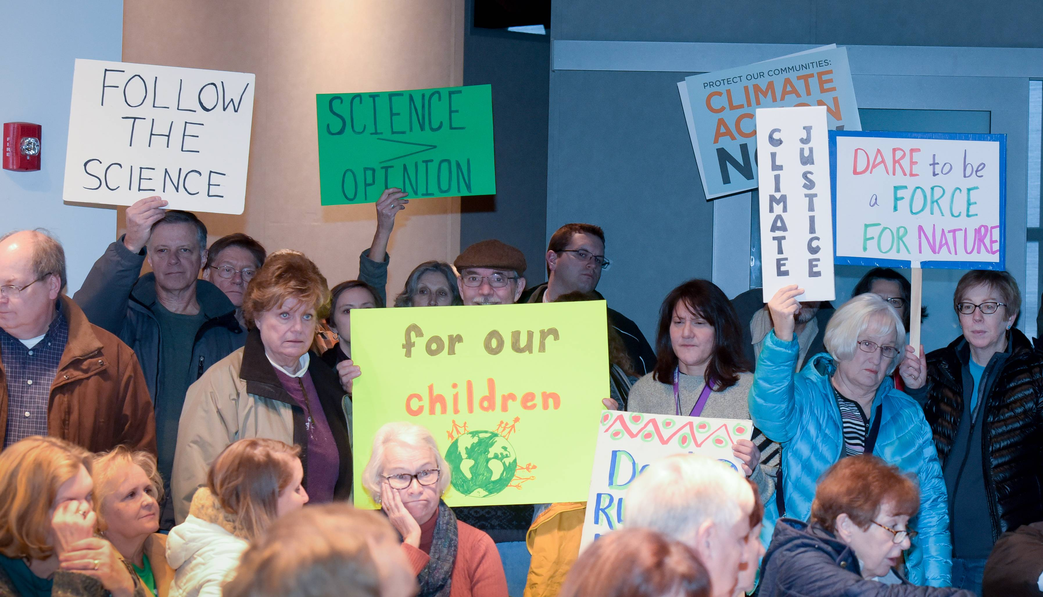 Local Sierra Club chapters and other groups organized a climate change rally where people dropped off postcards at U.S. Rep. Peter Roskam's office in West Chicago.