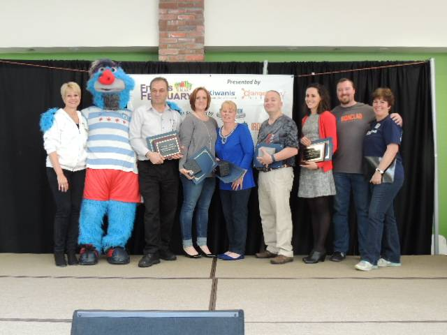 Pictured at the 2016 Health Lombard Health Heroes award presentation, from left, Healthy Lombard Foundation founder and board president Jay Wojcik; Supernova, mascot of the Chicago Red Stars women's soccer team who assisted in presenting the awards; Tony Topalidis, owner of Maxfield's Restaurant on Roosevelt Road in Lombard; Bonnie Kramer; Janiece Lewitke; Dave Frank; Alea Olson from Revolution Weight Loss and Physical Therapy; Health Hero sponsor Ben Tipton from IRONCLAD; and Health Hero chairwoman and Healthy Lombard Foundation board member Stephanie Schiszik.