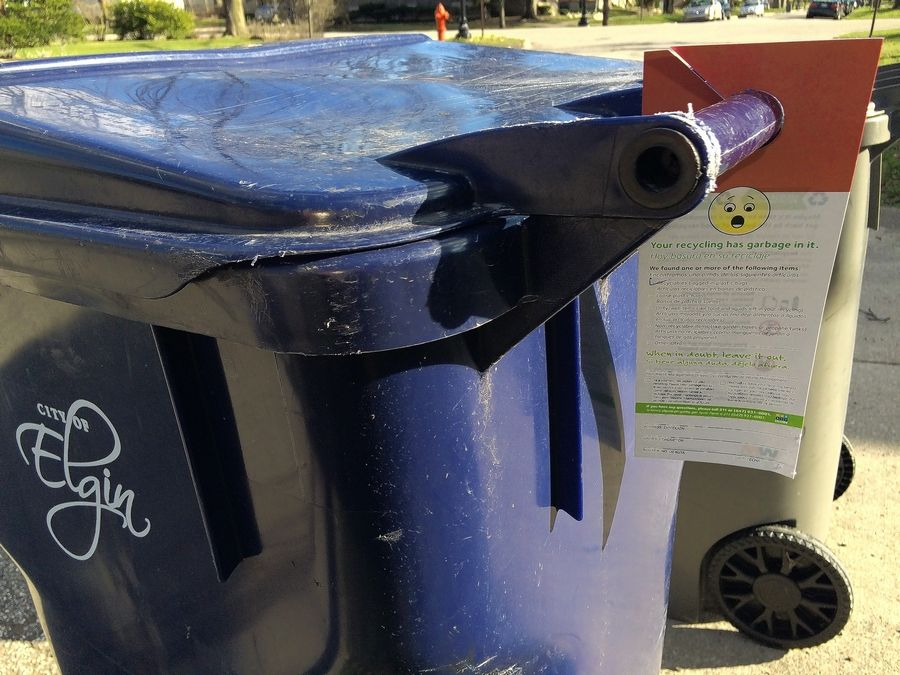 "This 2016 photo shows a red cart hanger for the ""Recycle Often. Recycle Right."" pilot program that targets recycling contamination in Elgin. The pilot program has been very successful, Waste Management told the city council Wednesday."