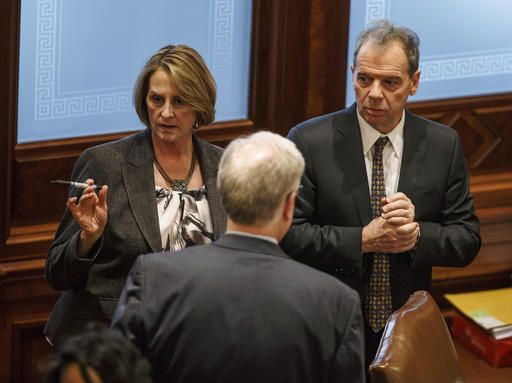FILE - In this Jan. 9, 2017, file photo, Illinois Senate Minority Leader Christine Radogno, R-Lemont, left, talks with Illinois Senate President John Cullerton, D-Chicago, right, at the Illinois State Capitol in Springfield, Ill. The Illinois Senate is putting the brakes on a compromise budget, plan but leaders say they still want to see it on track for a floor vote, Wednesday, Jan. 25, 201,  in the nation's longest budget deadlock in decades. (Justin L. Fowler/The State Journal-Register via AP File)