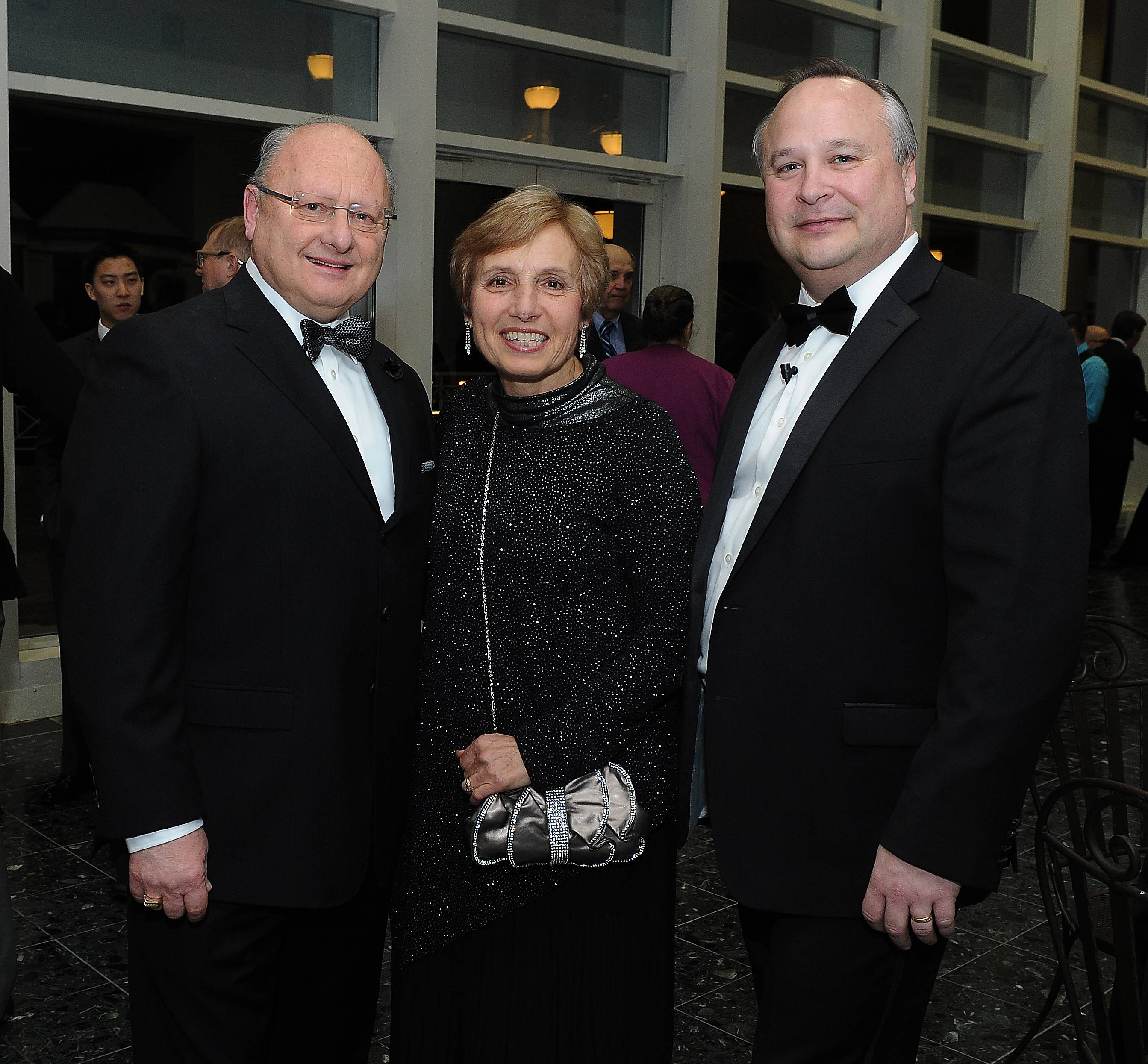 Frank Lesniak and his wife, Joanne, of Arlington Heights stand with Jon Ridler, right, executive director of the Arlington Heights Chamber of Commerce, at the chamber's 70th annual Installation and Awards Celebration at Arlington International Racecourse on Friday. Lesniak was the winner of the 2016 Business Volunteer of the Year Award.