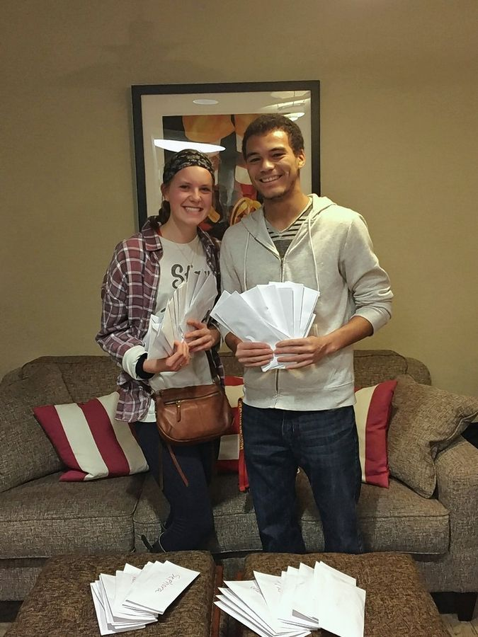 Naperville Central High School students Dana Roscoe and Peter Villanova prepare to donate more than $10,000 in gift cards to the Ronald McDonald Family Room at Edward Hospital in Naperville and the Ronald McDonald House near Lurie Children's Hospital in Chicago.