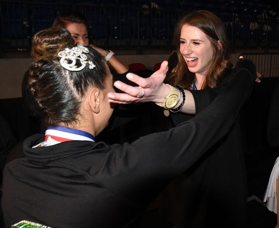 Analese Demaio of Stevenson hugs assistant coach Laura Michel after their big win in the 3A division Saturday during the Competitive Dance finals at U.S. Cellular Coliseum in Bloomington.
