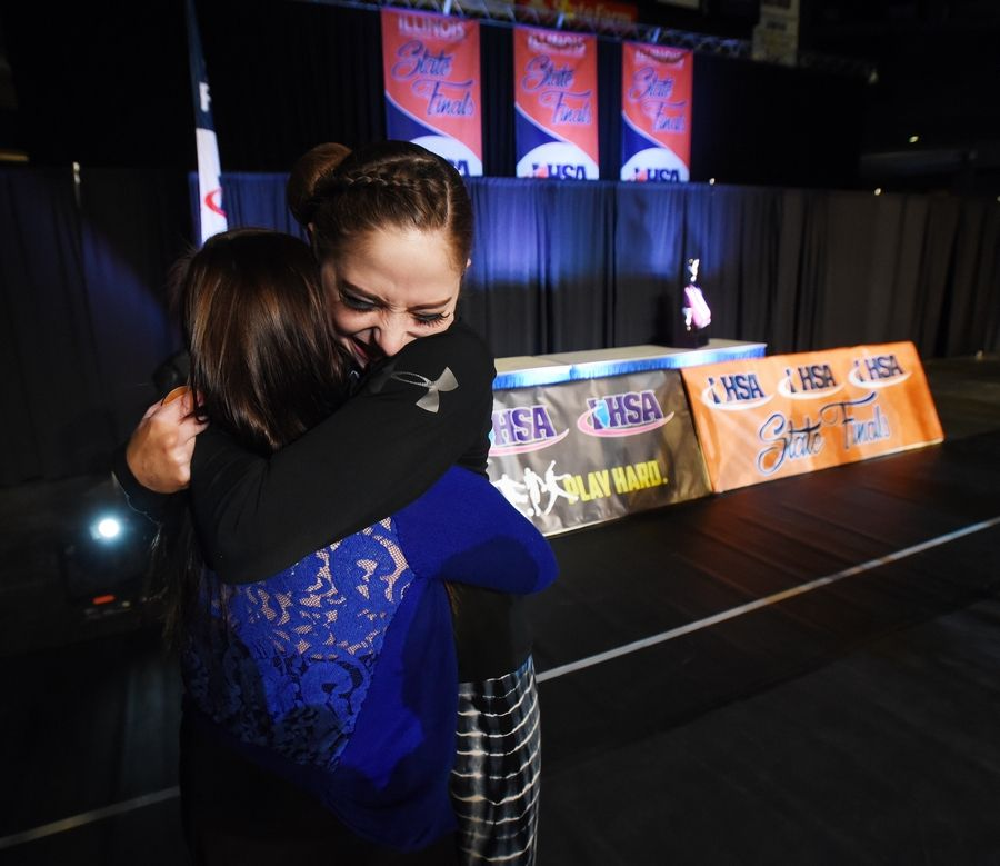 Carly Ruggeri of Geneva hugs her coach Amy Vanwagenen after the big win Saturday at the Competitive Dance finals at U.S. Cellular Coliseum in Bloomington.