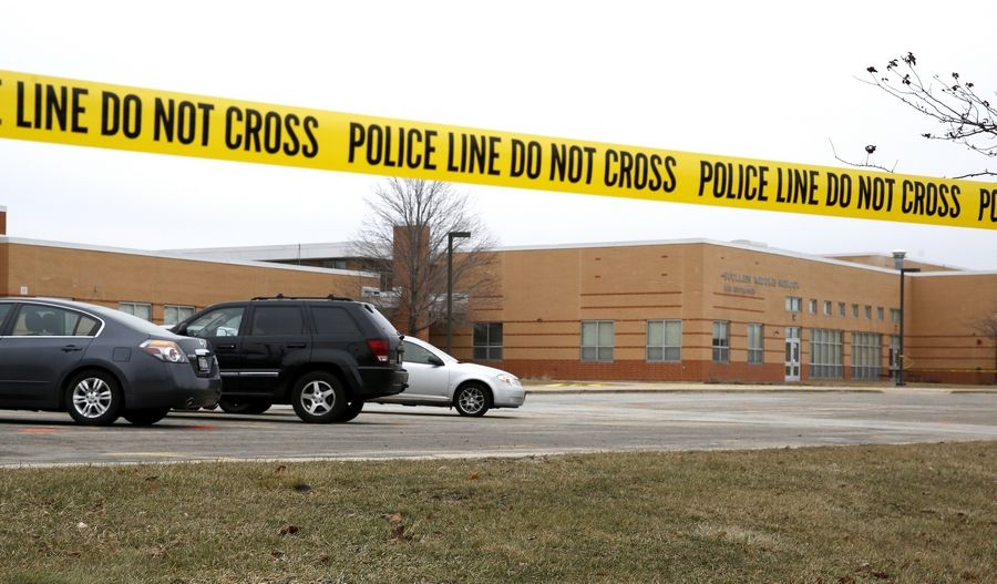 Naperville police Saturday still were searching for the person who shot and killed a 37-year-old Oswego man Friday night while he was waiting in this school parking lot to pick up his son from Polish class.