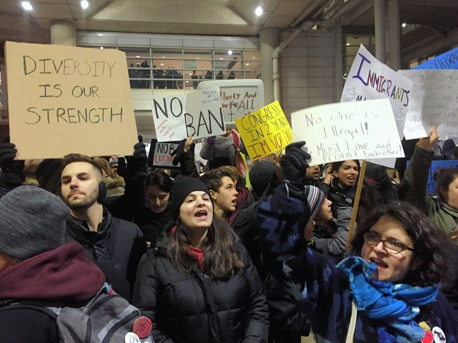 Hundreds of protesters gathered again Sunday night at O'Hare International Airport to protest President Donald Trump's ban on allowing some refugees into the United States.