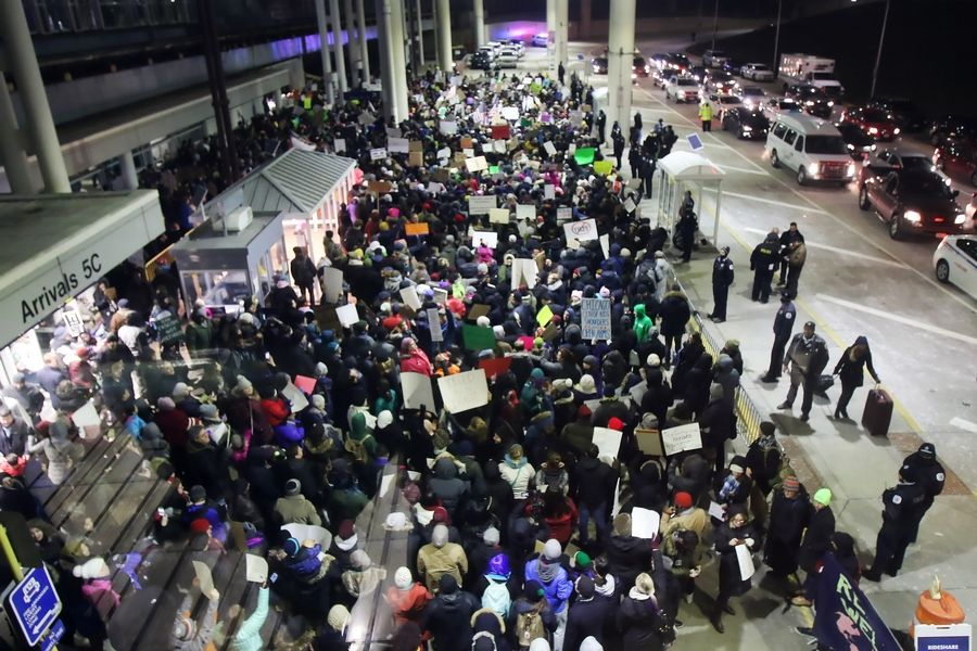 Hundreds of protesters demonstrated outside the international terminal Sunday night at O'Hare International Airport in Chicago. They protested the executive order by President Donald Trump restricting some refugees' travel to the U.S.