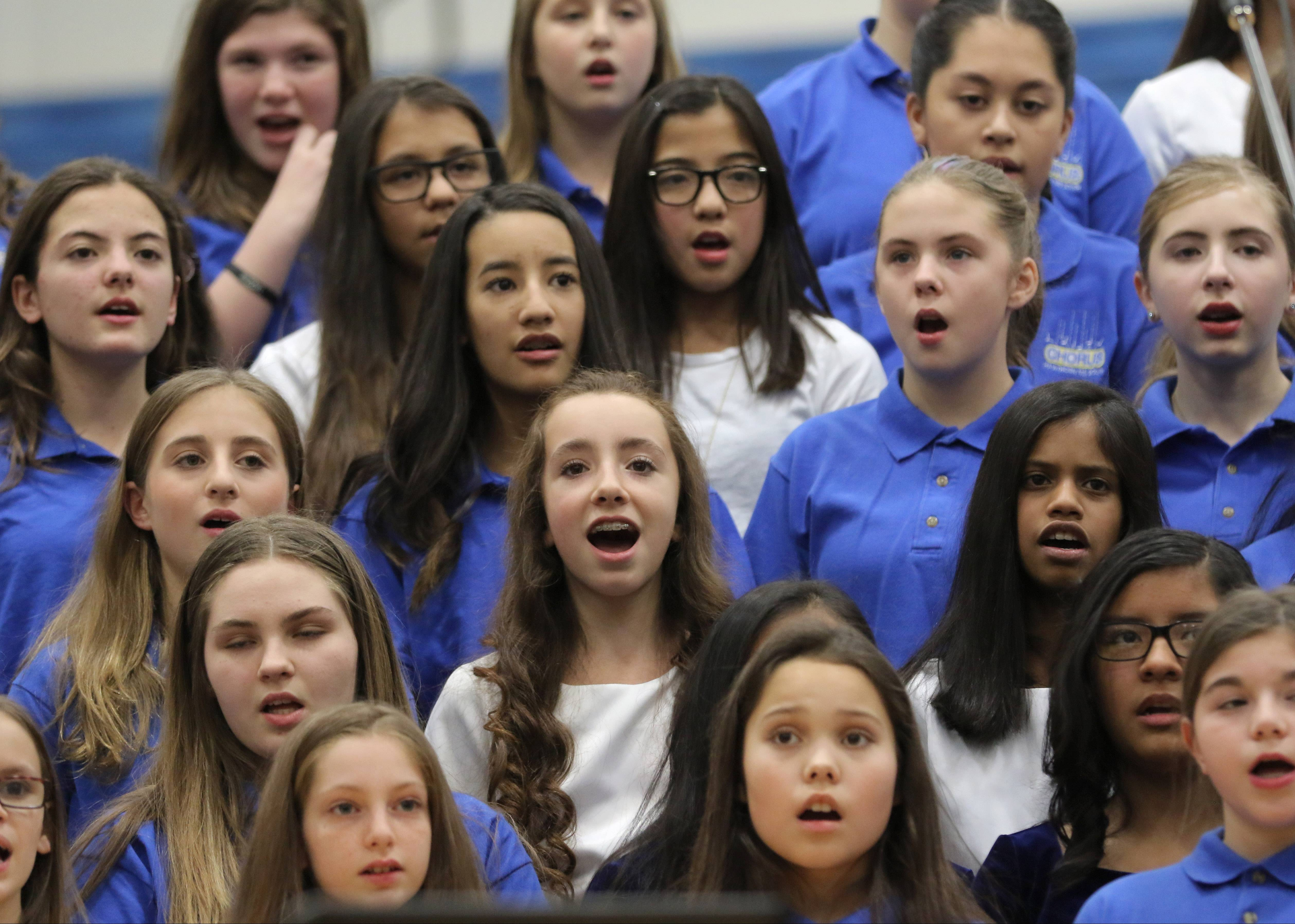 The Hawthorn Middle School North and South combined choirs perform during the 2017 Vernon Hills High School and Hawthorn Choir Festival Monday night at Vernon Hills High School.