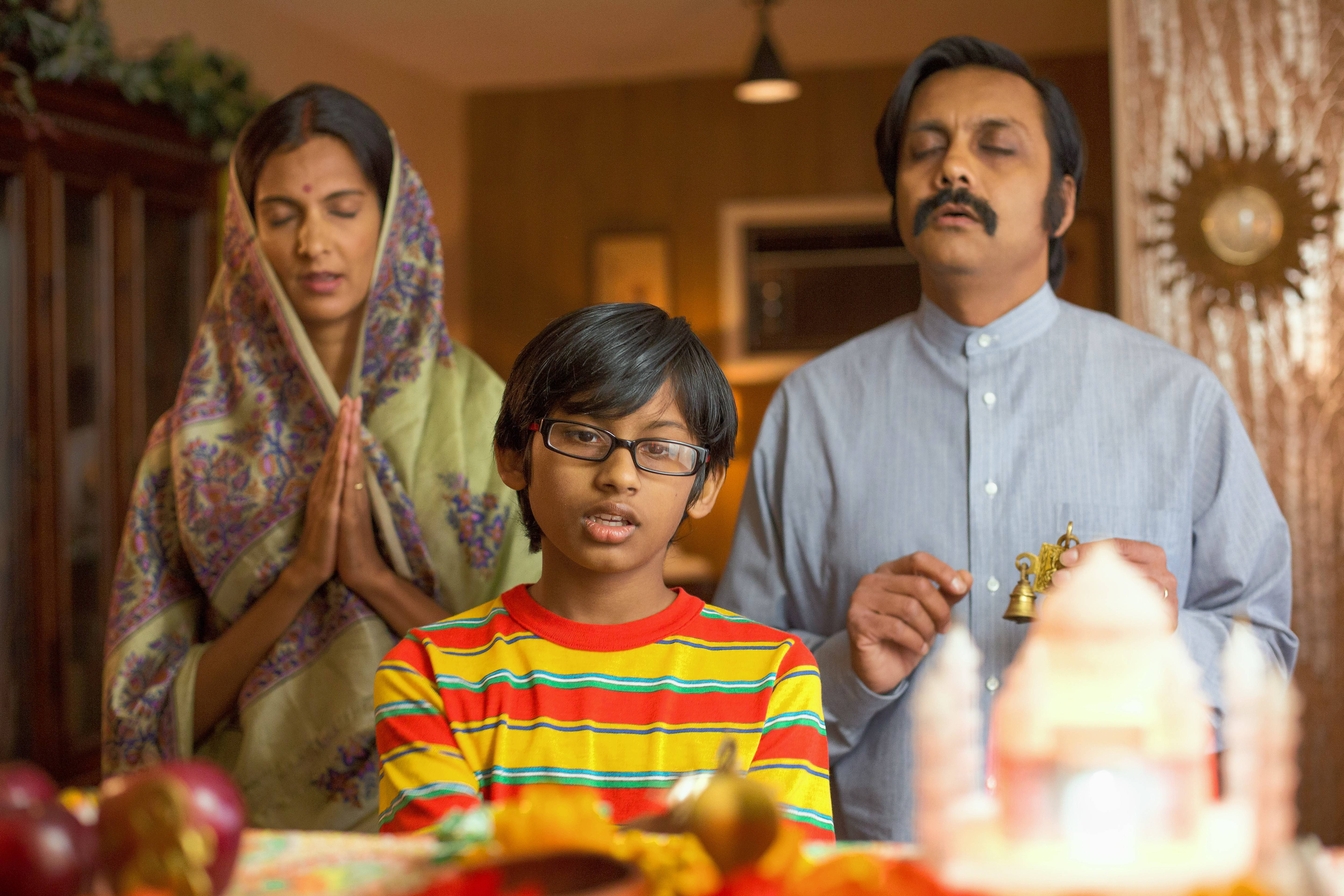 "Smith (suburban native Roni Akurati), foreground, copes with the culture clash between Americans and his India-born parents (Poorna Jagannathan and Anjul Nigam) in ""Growing Up Smith."""
