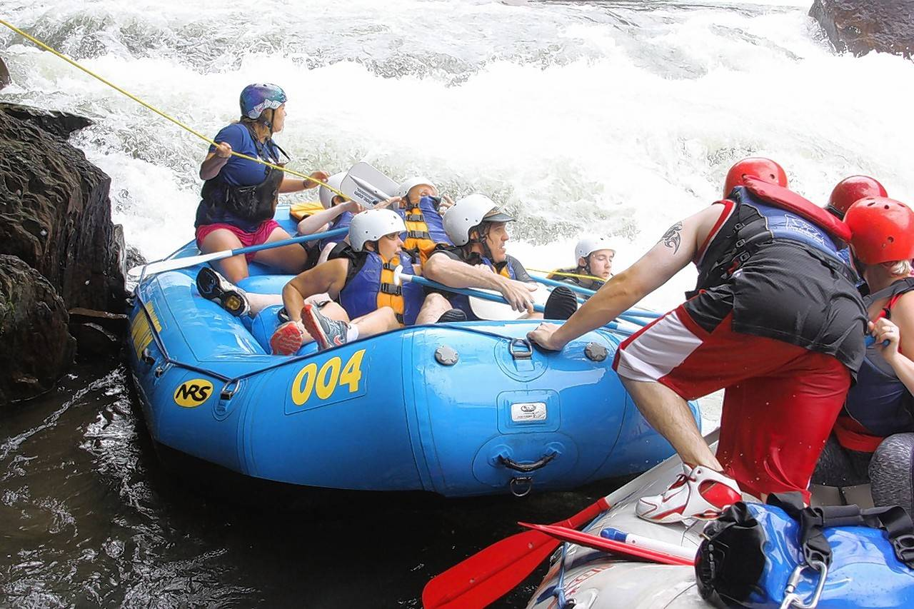 Lake Zurich High School senior Nathan Coirier, in white helmet on right just past men in red helmets, rescued his mother, who was knocked from this raft and into the Ocoee River rapids in Tennessee in August 2015. Lake Zurich Unit District 95 board members honored Coirier last week.