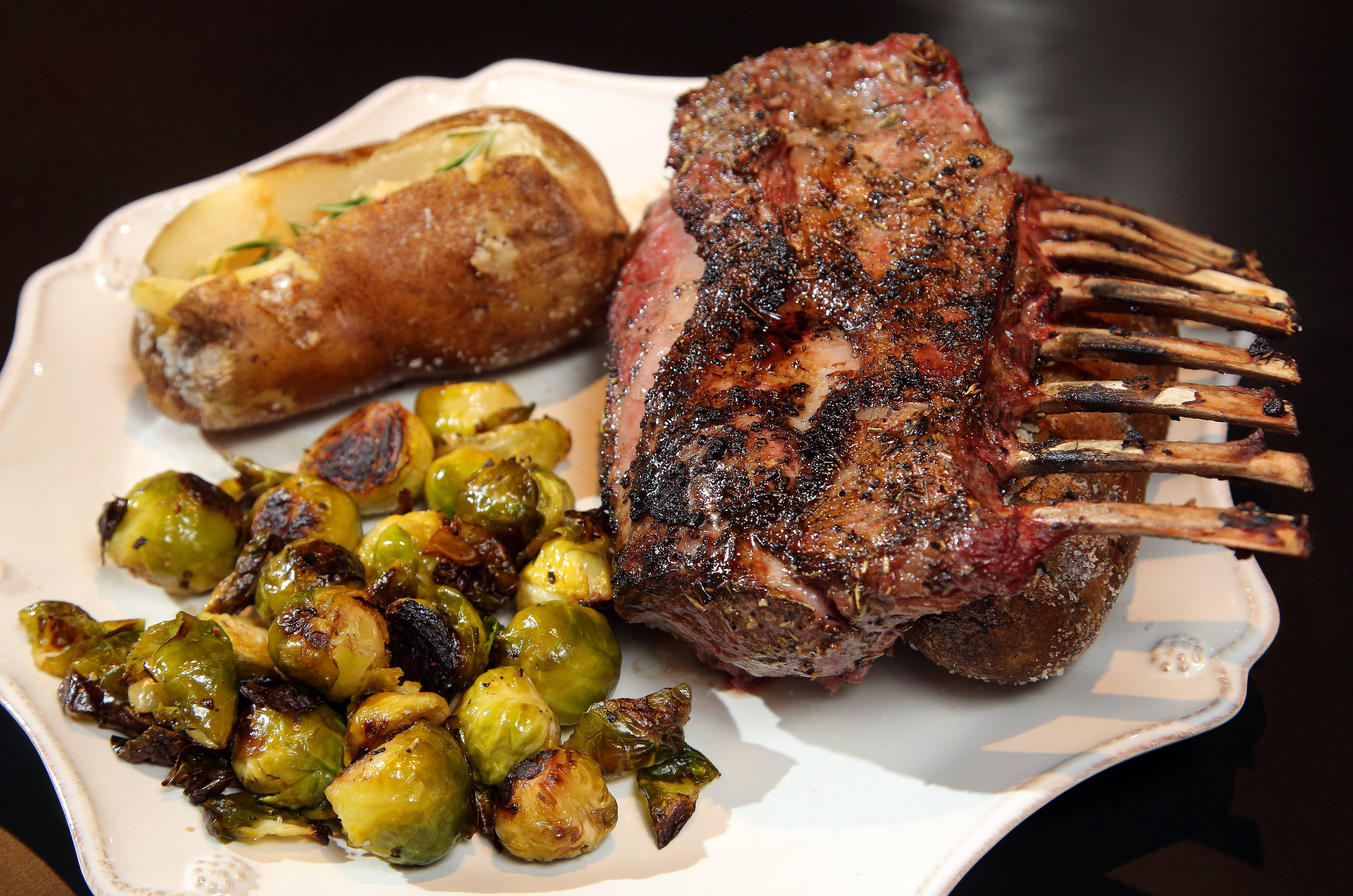John Harty and Sue Ascher of Riverwoods made rack of lamb with roasted brussel sprouts and baked potato.