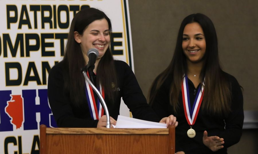 Team captains Abby Absher, left, and Analese DeMaio speak during a special ceremony Tuesday at Stevenson High School for the varsity Patriettes. The dance team won the IHSA Class 3A Competitive Dance state championship on Saturday.