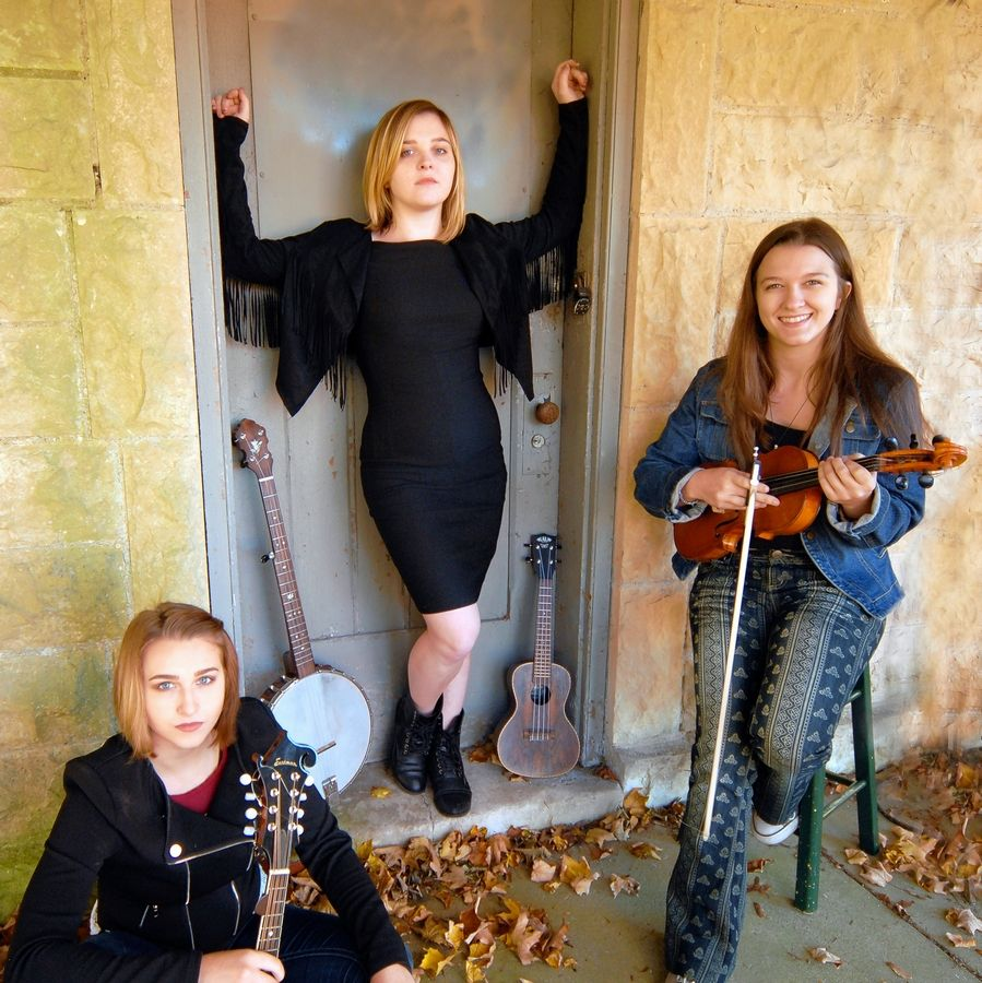 A state and national fiddle champion, 18-year-old Georgia Rae Mussared, right, performs with her sisters, Quin, 16, left, and Kelly Jo, 21, center, as part of the Georgia Rae Family Band from Richmond.