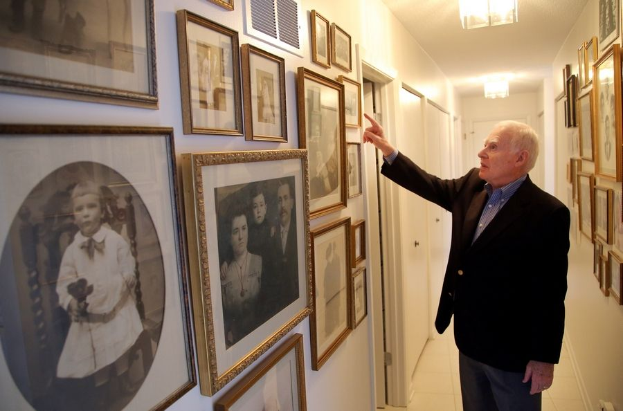 Ralph Rehbock of Northbrook looks through old pictures of his relatives from Germany. Rehbock was among German Jews allowed entry to the United States a refugee in 1938.