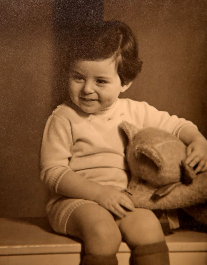 A photo shows Ralph Rehbock at age 2 in Germany.