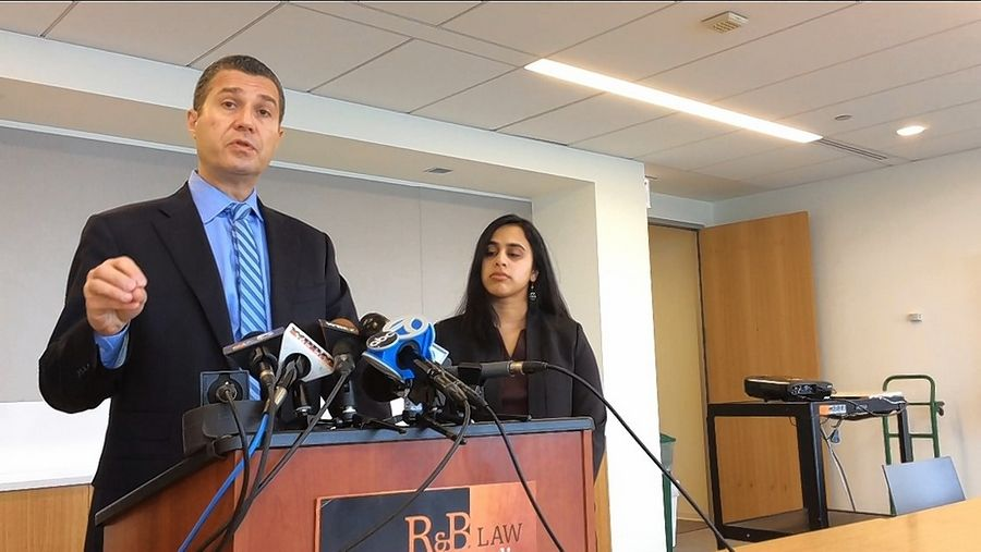 Attorney Antonio Romanucci, accompanied by lawyer Bhavani Raveendran at a news conference Wednesday, discusses a federal lawsuit filed on behalf of two student-athletes claiming they were hazed by teammates on the Lake Zurich High School football squad.