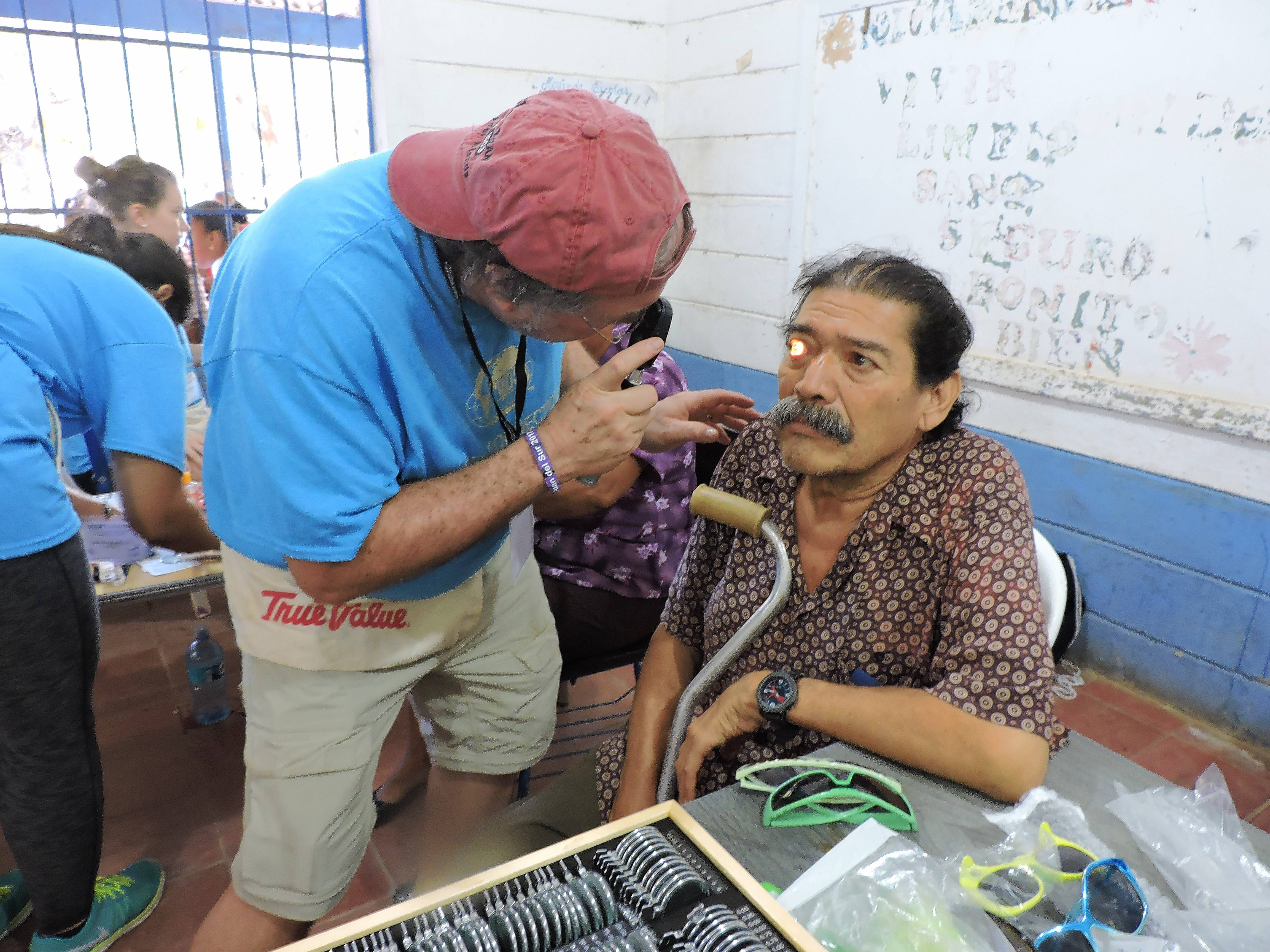 Dr. Larry Nierman examines one of the hundreds of patients he saw over the course of the week on a medical mission to Nicaragua with Volunteering Optometric Services to Humanity.