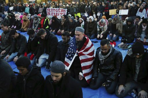 Rutgers University students and supporters gather for Muslim Prayers during a rally to express discontent with President Donald Trump's executive order halting some immigrants from entering the United States on Tuesday, Jan. 31, 2017, in New Brunswick, N.J.