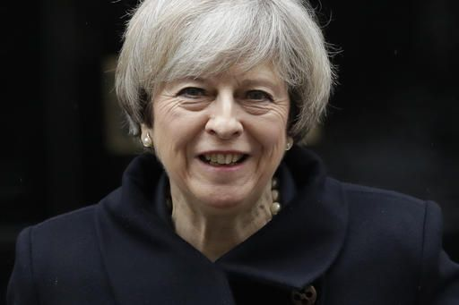 British Prime Minister Theresa May leaves 10 Downing Street in London, to attend Prime Minister's Questions at the Houses of Parliament, Wednesday, Feb. 1, 2017. Britain's House of Commons is to vote on a bill Wednesday authorizing Prime Minister Theresa May to start European Union exit talks - the first major test of whether lawmakers will try to impede the government's Brexit plans.