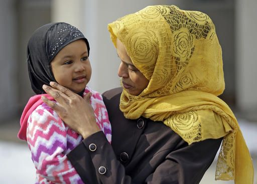 Somali refugee Nimo Hashi holds her daughter Taslim at their home Tuesday, Jan. 31, 2017, in Salt Lake City. Hashi bought a new kitchen table and couches for her Salt Lake City apartment in joyful anticipation of reuniting Friday with her husband for the first time in nearly three years. But he won't be arriving as planned to see her and the 2-year-old daughter he's never met. He is among hundreds of people stuck in limbo after President Donald Trump's executive order temporarily banned refugees and nearly all travelers from seven Muslim-majority countries, including Somalia.