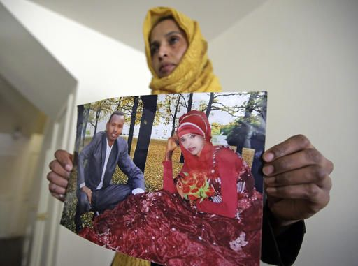 Somali refugee Nimo Hashi holds a photo of her husband Tuesday, Jan. 31, 2017,  in Salt Lake City. Hashi bought a new kitchen table and couches for her Salt Lake City apartment in joyful anticipation of reuniting Friday with her husband for the first time in nearly three years. But he won't be arriving as planned to see her and the 2-year-old daughter he's never met. He is among hundreds of people stuck in limbo after President Donald Trump's executive order temporarily banned refugees and nearly all travelers from seven Muslim-majority countries, including Somalia.