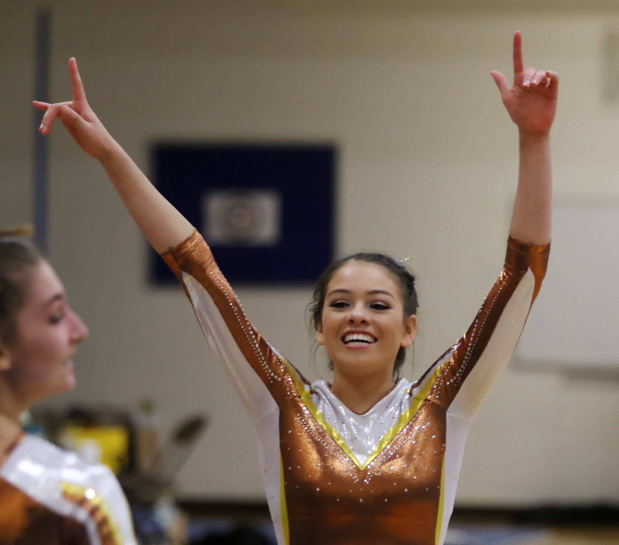 Carmel Catholic's Alyssa Legarreta celebrates with her teammates during the regional meet in Mundelein on Thursday.