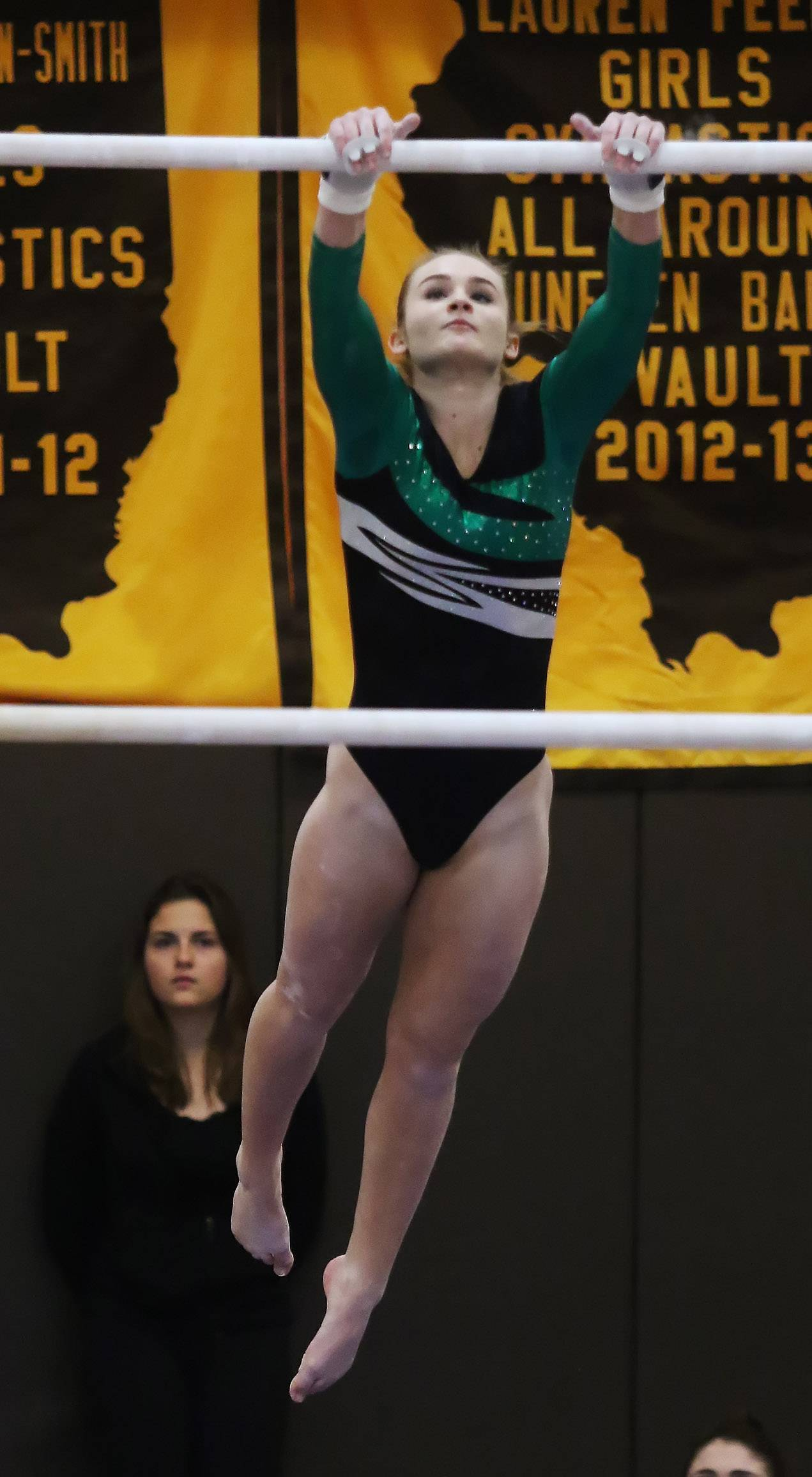 Stevenson gymnast Zoe Hinz performs on the uneven bars during the regional meet hosted by Carmel Catholic on Thursday.